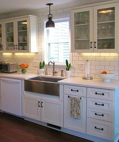 Stainless steal country sink. Like The White Cabinets and Hardware as well @Shirley Vitale Perfette