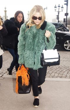 Mary-Kate and Ashley Olsen's Greatest Coat Looks of All Time   On Ashley Olsen: Marni coat; The Row bag.