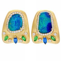 Delicious enough to dive into - as the Festival of Opal month, October edges to a close here is a pair of my favourite earrings from my latest collection. Opals of such outstanding colour and beauty are rare and when the miner in Lightning Ridge finds something such as this he always contacts me. I set them into satin finished 18K Gold with a border of diamonds and a burst of Sapphire and Tsavorite to highlight the blue/green play of colour in the Opal. As individual, unique and rare as…