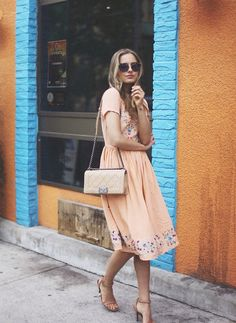 Shop this look for $216:  http://lookastic.com/women/looks/beige-crossbody-bag-and-beige-casual-dress-and-tan-sandals-and-navy-sunglasses/2763  — Beige Leather Crossbody Bag  — Beige Embroidered Casual Dress  — Tan Leather Heeled Sandals  — Navy Sunglasses