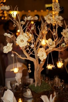 branch w flowers & votives centerpiece