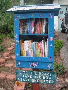 Little Free Library!  This idea is sweeping the nation apparently!  You just build a little library on your curb and leave books in it!  They can either just borrow it and return it later or swap it for one of theirs, depending on how you phrase your sign!  NRY