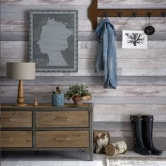 Create your very own cosy log cabin with this clever wood-effect wallpaper. A few rustic accessories add to the look.