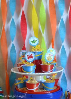 Beach Ball Pool Party . Love the sand bucket cupcake wrappers!