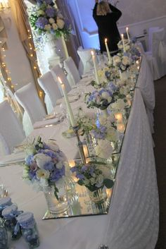 The Top Table looked magical with posies of fresh flowers set on mirrors illuminated by candlesticks and candlelit votives