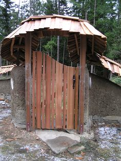 garden gates | This gate in a cob garden wall is made of hand split red cedar ...