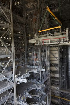 https://flic.kr/p/Qpmikp | KSC-20161216-PH_JBS01_0081 | The second half of the B-level work platforms, B north, for NASA's Space Launch System (SLS) rocket, is lowered by crane for installation on the north side of High Bay 3 in the Vehicle Assembly Building (VAB) at NASA's Kennedy Space Center in Florida. Construction workers will secure the large bolts that hold the platform in place on the north wall. The B platforms are the ninth of 10 levels of work platforms that will surround and…