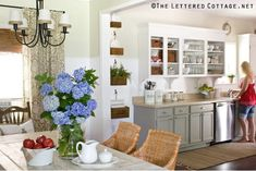 kitchen and breakfast area ideas; note the cabinet molding, two color cabinets, & decor details. like the shades on light fixture.