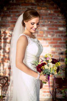 The breathtaking bride on her wedding day. ::Sydney + Tyler's exquisite fall wedding at the Carl House in Auburn, Georgia:: #bridalportrait #weddingmakeup by #BombshellCreations #bridalbouquet #flowers #weddingdress @Carl Lindgren House Wedding Venue