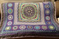 It's on Ravelry... Called Sophie Loves Lilla Bjorn Winter Blanket. It incorporates other patterns. Links:http://www.lillabjorncrochet.com/2015/06/circles-of-sun-mystery-cal-general.html Dandelion Mandala: http://www.ravelry.com/patterns/library/dandelion-mandala-overlay-crochet Dandelion Border (DB): http://www.ravelry.com/patterns/library/dandelion-border---overlay-crochet Sophies Garden: http://www.lookatwhatimade.net/crafts/yarn/crochet/sophies-universe-cal-2015/sophies-universe-calpart…
