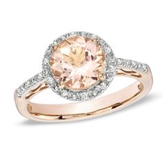 7.0mm round-shaped pale pink morganite center stone. A halo frame of shimmering accent diamonds wraps this gemstone in a sparkling embrace, while additio........this will be my ring!!!!!!