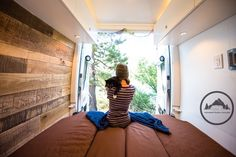 A girl and her cat enjoying life on the road in their Sprinter Van home. Custom conversion by Townsend Travel Trailers