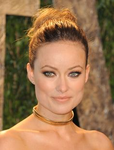 Olivia Wilde-She's got steel gray around her lashes, copper on her upper lids and gold along her lower rims. Love this look.