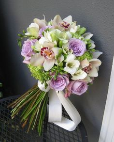 lavender green white weddings | Bridal bouquet with lavender roses, orchids, white freesia and ...