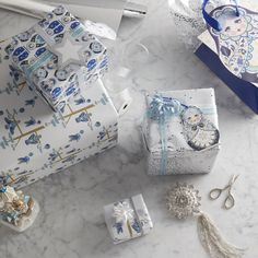 A palette of sapphire blues and glamorous golds creates a sophisticated seasonal setting that's full of wonder befitting of the theme's palatial name. Adorn your presents with Winter Palace's Babushka printed paper and finish with luxurious velvet ribbon.