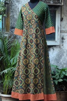 an anghrakha dress with a flap in the front makes it a perfect wear for special occasions! the dress has 2 pockets on the sides. African Fashion Dresses, Indian Dresses, Indian Fashion, Salwar Designs, Kurta Designs Women, Batik Dress, Abaya Fashion, Indian Attire, Pakistani Outfits