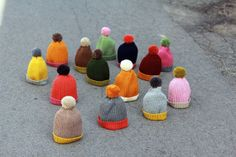 Colorful beanies with pompoms.