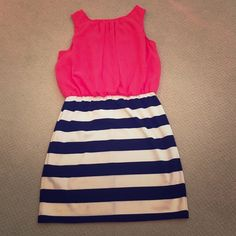 Striped Party Dress This dress is super adorable! Looking for a new home. Worn a couple of times but in great condition! Poppy red blouse attached to black and white striped skirt to make this cute cute dress! Super comfortable too! Ruby Rox Dresses Mini
