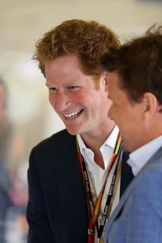 Prince Harry speaks with former driver Sir Jackie Stewart and Mark Stewart before the British Formula One Grand Prix at Silverstone Circuit on July 6, 2014 in Northampton, United Kingdom.