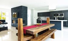 a large wooden dining table in the kitchen-diner and living space of a remodelled bungalow