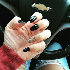 Black and gold coffin nails are a subtle nail look that's perfect for Halloween.
