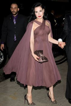 En route to the Met gala after party, Dita Von Teese wore a draped Zac Posen dress from spring. [Photo by Dave Kotinsky/Getty Images]