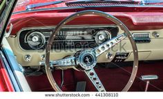 GROSSE POINTE SHORES, MI/USA - JUNE 19, 2016: Close up of a 1964 1/2 Ford Mustang dashboard at the EyesOn Design car show, held at the Edsel and Eleanor Ford House, near Detroit, Michigan.