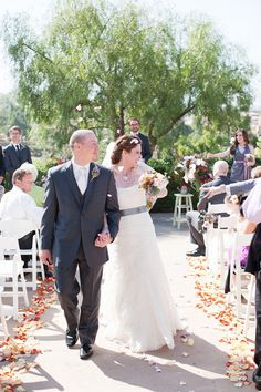 Just Married - Bride and Groom walk down the aisle // Weddings at The Crosby Club in Rancho Santa Fe