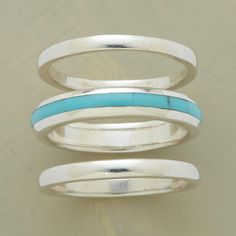 STREAK OF TURQUOISE RING TRIO -- A streak of hand-inlaid turquoise embellishes the wider center ring of our turquoise stack ring trio of polished sterling silver bands. Set of 3