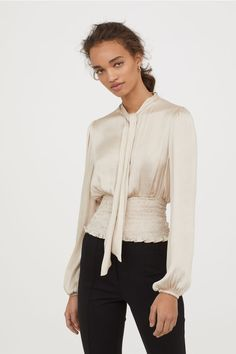 Blouse in satin with wide smocking at hem. Open section at top, draped collar with long ties at front, and long balloon sleeves with elasticize Satin Blouses, Shirt Blouses, Office Fashion, Kids Fashion, Women's Fashion, Classic White Shirt, Long Ties, White Shirts, Smocking