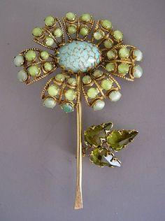 SCHREINER aqua and green rhinestones and cabochon center flower pin