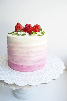 moist and rich vanilla buttermilk cake (plenty of butter and extra yolks); filled with fresh strawberries; filled with a homemade strawberry compote infused cooked flour buttercream; covered in vanilla swiss meringue buttercream