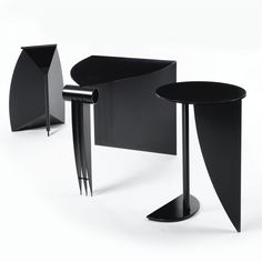 "Martin Szekely SUITE OF FURNITURE comprising ""Pi"" gueridon, bureau and wastepaper basket lacquered steel (desk illustrated on back cover) table: 29 1/4 in. (74.3 cm) high; 19 3/4 in. (50.3 cm ) diameter desk: 28 3/4 x 37 x 26 3/4 in. (73 x 94 x 67.9 cm) wastepaper basket: 29 1/4 x 13 3/8 x 19 1/2 in. (74.3 x 34 x 49.5 cm) ca. 1985 each manufactured by Néotu, Paris"