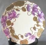 """Pretty 7 3/4"""" Art Nouveau plate with water lilly type flowers  in shades of lavenders and olive leaves outlined in gilt."""