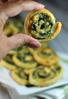 Mmm…golden, flaky puff pastry wrapped around melted cheeses and hearty, garlicky spinach, shaped into cute little spirals - these Cheesy Spinach Pinwheels make a perfect appetizer. Only 110 calories or 3 Weight Watchers points for two pinwheels! www.emilybites.com