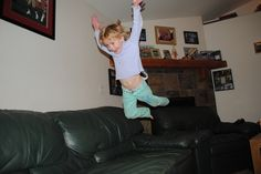 Jumping on the couch.  Is allowed, kido!