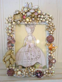 Picture frame with brooches - I bet Anna Nygaard could make an amazing one of these!