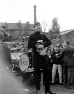 """John and the lads , 5th of August 1963. Abbotsfield Park, Chassen Road, Urmston, England. Between the time of their first album """" Please Please Me"""" and their second album """" With The Beatles""""."""