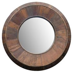 Beveled wall mirror with a distressed wood frame.  Product: Wall mirrorConstruction Material: Wood and mirrored ...