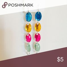 Color Blocked Long Earrings Color blocked long dangling earrings. Colors on earrings include blue, orange, magenta and mint green. Other colors also available. Jewelry Earrings