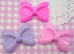 Extra cute and extra large pastel bows in fuchsia, purple and pink. These flat back resin cabochon beads are perfect for all kinds of kawaii crafts, including decoden. #DIY #Craft