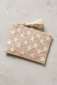 Estrella Pouch #anthropologie - straw clutch with embroidered stars - love it!