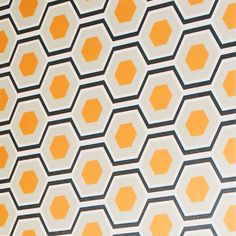 Showcasing a hexagon motif for geometric-chic flair, this peel-and-stick wallpaper square brings regrets-free style to any room. Make a bold statement on an ...