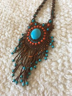 A personal favorite from my Etsy shop https://www.etsy.com/listing/572370474/copper-turquoise-orange-beaded