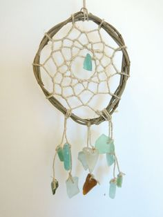 Sea Glass Dream Catcher  I like the bits of tumbled glass on this one, but wish the fringe was longer.