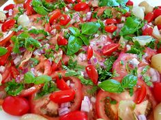 Tomato red onion and Basil salad with a sweet and sour dressing