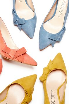 Suede mid heel pumps with ladylike bows and pointed toes