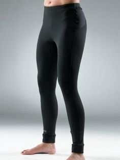 Zoot RUNfit Tight - Color: Black,Size: X-Small Hip Holster pockets. Clean-finish cuffs. Reflective logo detail. SeamLink stitch construction.