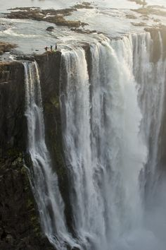 Ultimate Travel Bucket List: 20 Incredible Experiences | Sunday Chapter  SWIM IN DEVIL'S POOL IN AFRICA