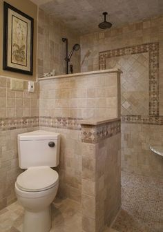 14 Great Ways to Design Corners in the Bathroom   The commode. The way this unit is angled gives more room on either side in this semiprivate stall.